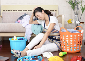 Exhausted Mum Trying To Clean Home